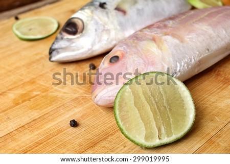 Fresh raw fish ,lemon and pepper - stock photo