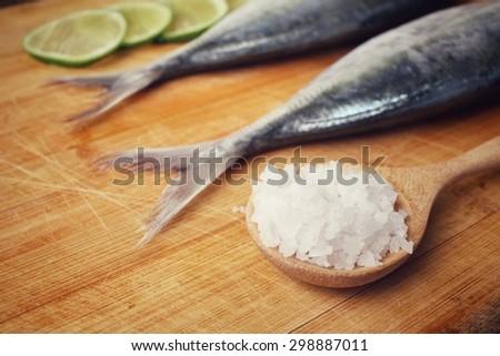 Fresh raw fish ,lemon and salt - stock photo