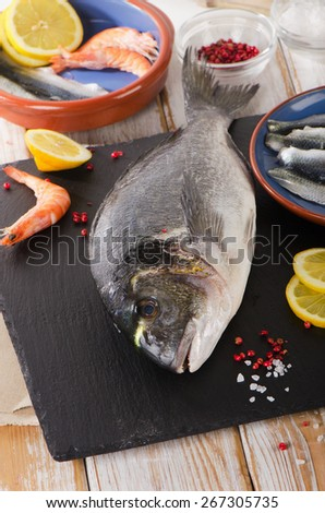 Fresh raw fish  with  spices and shrimps - healthy food. Diet  concept. - stock photo