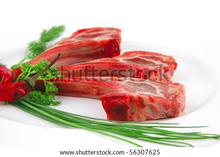 fresh raw lamb ribs served on plate - stock photo