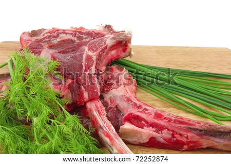 fresh raw meat : fresh red beef ribs with dill and green sprouts on wooden board isolated over white background - stock photo
