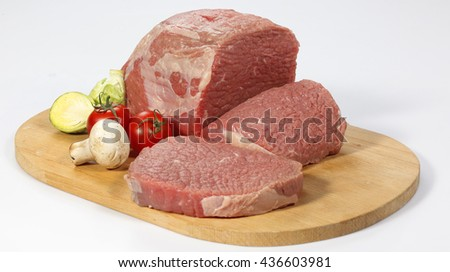 Fresh raw meat on cutting board - stock photo