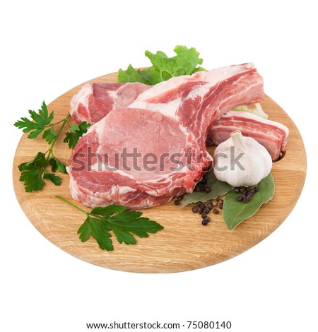 Fresh raw meat pork on cutting board in closeup over white background
