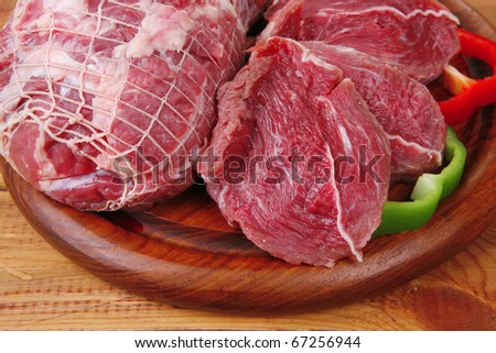 fresh raw meat prepared for cooking on wood - stock photo