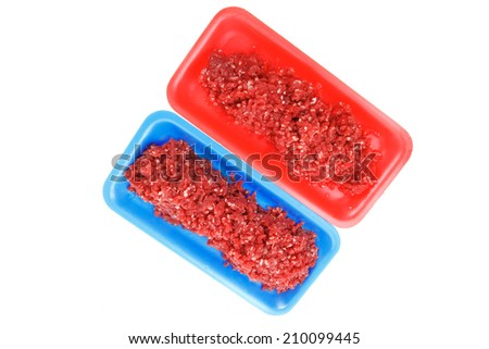 fresh raw mince beef meat on red and blue tray's isolated over white background