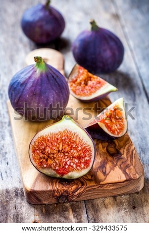 Fresh raw organic figs on a wooden background - stock photo