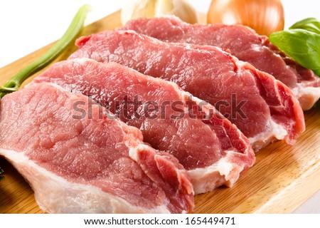 Fresh raw pork chops on white background  - stock photo