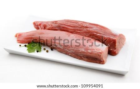 Fresh raw pork loin on white background - stock photo