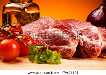 Fresh raw pork on white cutting board  - stock photo