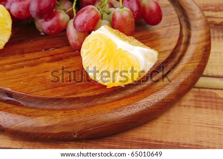 fresh raw red grape on wooden table - stock photo