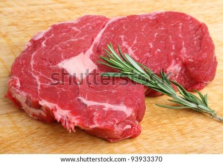 Fresh raw rib-eye beef steak - stock photo