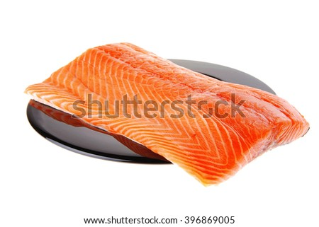 fresh raw salmon fillet on black over white - stock photo