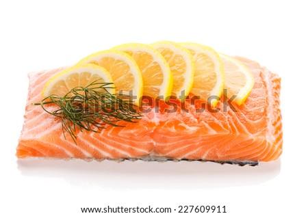 Fresh raw salmon fillet on white background - stock photo