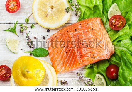 Fresh raw salmon fillet on wooden rustic table - top view. Healthy food, diet or cooking concept. - stock photo