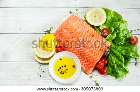 Fresh raw salmon fillet on wooden rustic table with place for your text. Top view seafood photo. Healthy food, diet or cooking concept. - stock photo