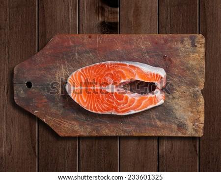 fresh raw salmon on wooden cutting board  - stock photo