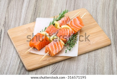 Fresh raw salmon skewer with pepper and rosemary