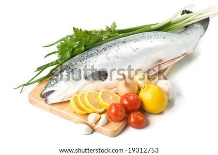 Fresh raw salmon with vegetables on a white background - stock photo