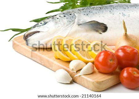 Fresh raw salmon with vegetables on a white background
