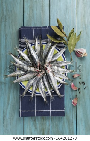 Fresh raw sardines on the table of the kitchen to be cooked. - stock photo