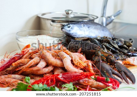 Fresh raw sea foods and fish at cooking table  - stock photo