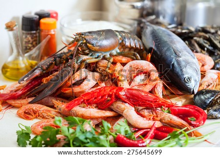 Fresh raw seafoods and fish at cooking table - stock photo