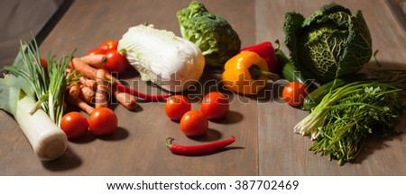 Fresh raw set of vegetables on wooden table