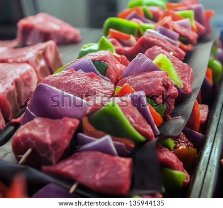 fresh raw shish kebab with veggies ready to be cooked - stock photo