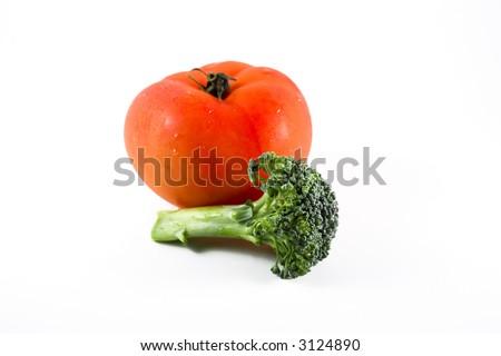 Fresh raw tomato and broccoli on white background - stock photo