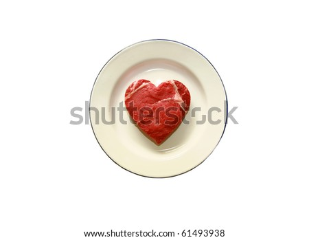fresh raw USDA beef steak cut into a heart shaped on a plate - stock photo