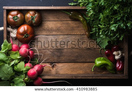 Fresh raw vegetable ingredients for healthy cooking or salad making on rustic wooden background, top view, copy space. Diet or vegetarian food concept. - stock photo