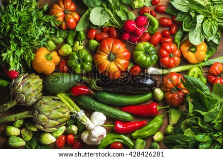 Fresh raw vegetable ingredients for healthy cooking or salad making, top view. Diet or vegetarian food concept - stock photo