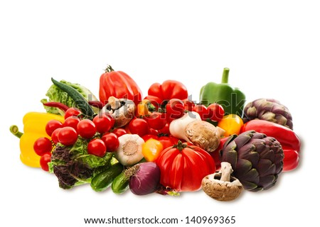 fresh raw vegetables and herbs isolated on white background. food ingredients. tomato, paprika, artichoke, mushrooms, cucumber, green salad, garlic