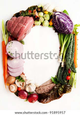 Fresh Raw Vegetables and Meats Shaped into Number Zero or Letter O - stock photo