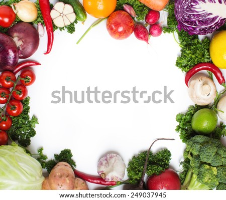 Fresh raw vegetables on a white background. Healthy and wholesome food. - stock photo
