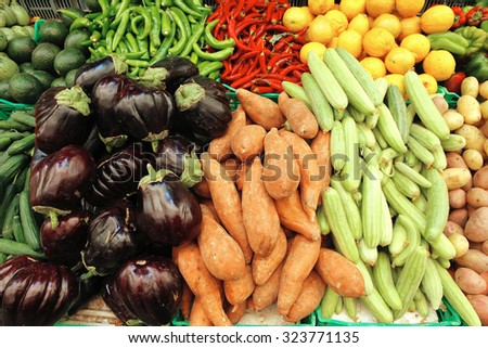 fresh raw vegetables red hot chili pepper green pepper lemons on market