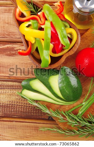 fresh raw vegetables served for salad on wood - stock photo
