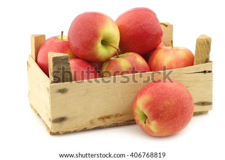 fresh red and yellow apples in a wooden crate on a white background - stock photo