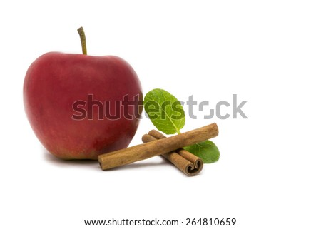 Fresh red apple, cinnamon and green mint leaves. - stock photo