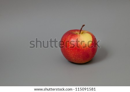 Fresh red apple on grey background