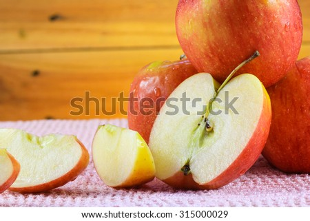 Fresh red apple on wood background - stock photo