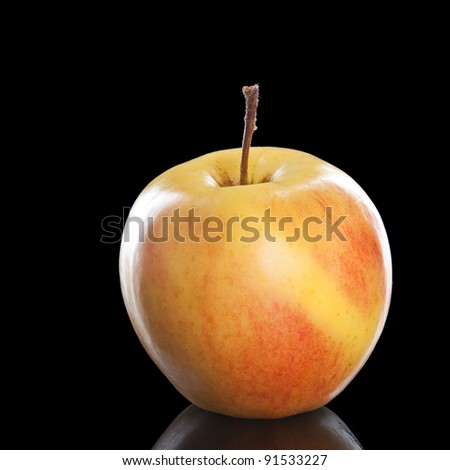 fresh red apple over black background