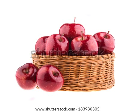 Fresh red apples in a wicker basket, isolated on white background. - stock photo