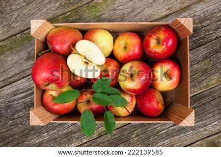 Fresh red apples in a wooden crate - stock photo