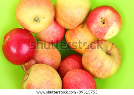 Fresh red apples in basket GREEN background.