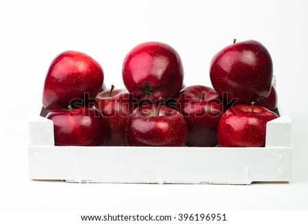 Fresh red apples in white wooden basket isolated on white background - stock photo
