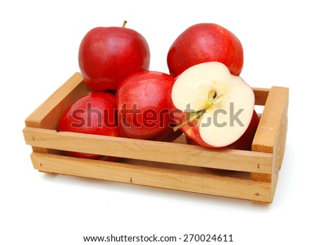 fresh red apples isolated in wooden crate on white background