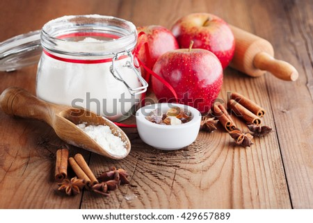 Fresh red apples, spices and baking ingredients for apple pie on rustic wooden background, selective focus - stock photo