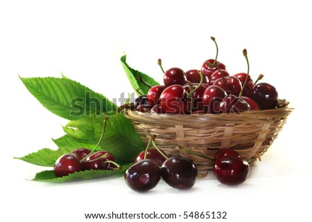 fresh red cherries in a small basket
