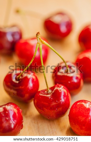 Fresh Red Cherries on Aged Wooden Table - Shallow Depth of Field